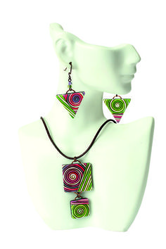 Emma Ralph's extruded geometric pendant.  Make with a bezel or not.  #Polymer #Clay #Tutorials