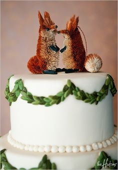 Fox Christmas ornaments as a cake topper - Photo by Jason