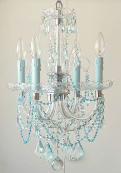 Bring the ocean breeze indoors with this delicate vintage-inspired Sea Blue Chandelier.