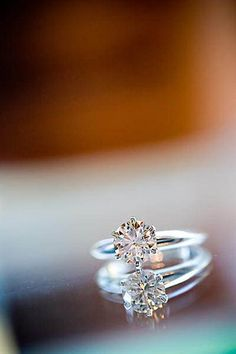 Simple and utterly beautiful. If it was the birthstone of my groom, It'd be my dream wedding ring.