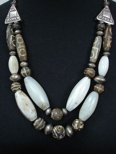 Old African Agate, Fossilised Wood and Silver Necklace by GEMILAJewels on Etsy https://www.etsy.com/listing/123477970/old-african-agate-fossilised-wood-and