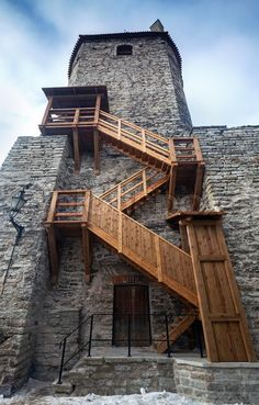 Ancient stone fortress with wooden stairs in old Tallinn, Estonia Classical Architecture, Historical Architecture, Ancient Architecture, Medieval Houses, Medieval Castle, Gate Images, Castle Project, Castle Gate, Old Barn Doors