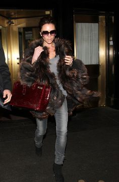 """Victoria Beckham Printed Tote  Mrs. Beckham showed off another one of her """"Birkin"""" bags. The fashionista owns enough to open up her own boutique. The crocodile printed bag added some color to her winter look.   Brand: Hermes"""