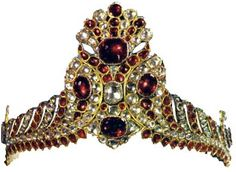 The Hat decoration of Fath Ali Shah. The gemstones are mainly spinels and diamonds, with perhaps a few rubies. The largest spinel in the tiara is 50 carats, and the largest diamond 10 carats in weight. The height of the tiara is 13.5 cm. The tiara defies an accurate description because of its unique design and perfect symmetry.