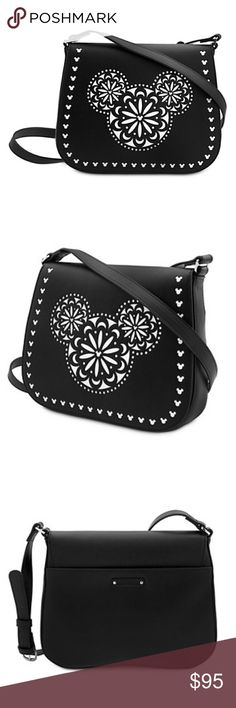 Vera Bradley Laser Cut Mickey cross body bag Disney world exclusive!! Mickey's fa-mouse icon is fashioned into a folk-art influenced fantasia on Vera's fine fashion black faux-leather. Duo-tone faux leather bag Laser cut Mickey icon design overlay Magnetic flap closure Open exterior pocket Interior zippered pocket with faux-leather pull Two open top pockets, including cell phone pocket Fabric lined Adjustable faux-leather crossbody strap with buckle Silvertone hardware Embossed Vera Bradley…