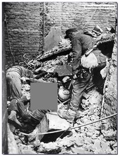 A SS non-commissioned officer inspects the bodies of two of the Warsaw insurgents killed in the Old Town. November 1944.