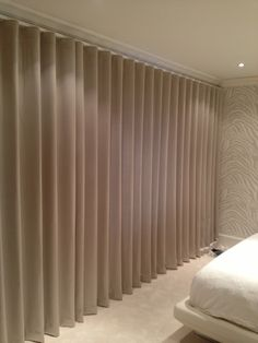 Wave heading on motorised track - Fabric #Evitavonni #interiordesign #curtains