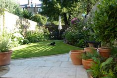 Catherine Clancy, garden designer based in Greenwich and Blackheath, London. offers, garden design, lighting design, planning applications, construction drawings, planting design, tender preparation,