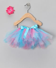 Any little pixie princess needs a magical outfit to create some fanciful fun. This sweet set includes a vibrant tutu with an adjustable ribbon waistband and a darling rhinestone-centered flower clip that can be attached almost anywhere that needs a little panache.  Includes tutu and clipTutu: tulleClip: polyester / metal...