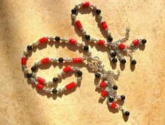 Coral jewellery with black agate - Coral and Black Agate combined in this meaningful necklace for protection and to encourage calm 'under fire'