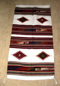 """A high quality woven wool rug similar to those woven by Native American's in the southwest. 32x64"""" with tassled corners. Durable enough for everyday traffic, but so pretty it can be used as a tapestry! $79.95 #rug #throwrug #southwestern #homedecor"""