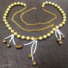 Kamarband and Belly Chains Women's Beaded Gold Plated Kamarband Base Metal: Alloy Plating: Gold Plated Stone Type: Artificial Beads Sizing: Adjustable Type: Chain Multipack: 1 Sizes: Free Size Country of Origin: India Sizes Available: Free Size *Proof of Safe Delivery! Click to know on Safety Standards of Delivery Partners- https://ltl.sh/y_nZrAV3  Catalog Rating: ★4.1 (2542)  Catalog Name: Women's Baeded Gold Plated Kamarband CatalogID_761845 C77-SC1420 Code: 961-5157014-