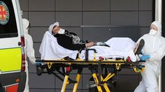 Michael Walsh is wheeled into the emergency department of the Gold Coast University Hospital on Thursday.
