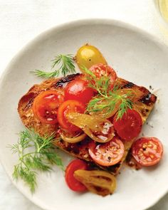 Mixed Tomatoes with Balsamic and Dill Bruschetta | Use a combination of colors and varieties of miniature tomatoes, such as cherry and teardrop, to make this fast, fresh bruschetta. Toss the halved tomatoes with balsamic vinegar, olive oil, and crushed red-pepper flakes, pile onto garlic toasts, and garnish with dill sprigs.