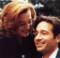 mulder & scully & just a cute pic (smiling yay & sculls' glasses double yay)