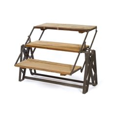 unusual reclaimed wood and iron piece swivels in place for use as a chic, rustic coffee table, or a standing or leaning bookshelf.