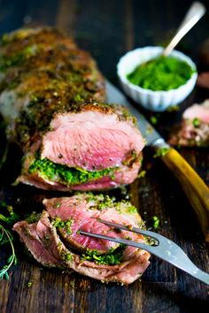 Herb Crusted and Stuffed Leg of Lamb with Mint Gremolata, a step by step guide to an amazingly delicious holiday main course, baked over roasted vegetables. | www.feastingathome.com