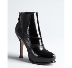 Prada black  leather swirl stitched ankle boots