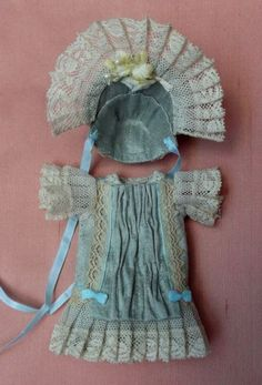 Antique style outfit in duck egg natural silk for mignonette, antique laces