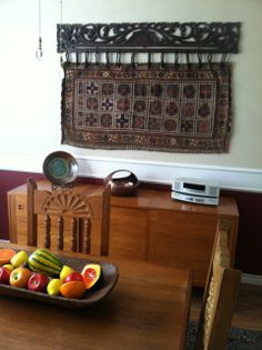 The Carved Panel Textile Hanger from Gado Gado is a lovely complement to the vintage tribal textile from Iran. Photo courtesy of our client. www.GadoGado.com