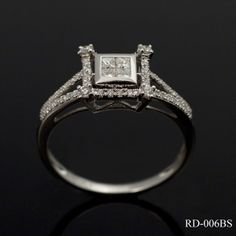 This complex contemporary design is simply stunning. The four central princess cut diamonds are housed in a rubover setting and are positioned within a pretty diamond set border containing four diamond corner stones (.37ct total) The split diamond set shank and the shaping of the diamond surround give this ring an oriental feel. £995