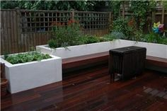 small garden that makes the best use of space with a cantilevered bench and raised beds