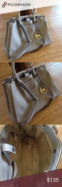 Michael Kors Purse/Crossbody Used in good condition no damage needs a light cleaning. Please view all the pic shows the condition of the bag. Offers Welcome Michael Kors Bags Satchels