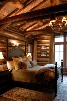 Modern rustic log cabin - love this cabin bedroom!