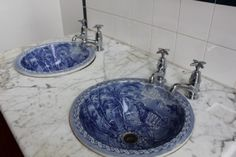 Beautiful blue and white porcelain sinks set in white marble...too bad they didnt continue the marble up the backsplash...