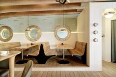 A curved ship's prow adjoins the kitchen and acts as bar counter and servery in order to integrate the 'galley' overlaid with steel bands and metal sheeting painted white.