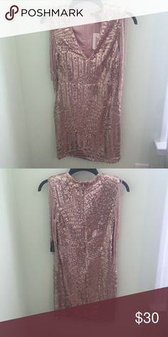 Dress This Rose Gold Sequin dress is perfect for a night out, New Years, or even a wedding. With no sleeves, a low v cut, and stopping just short of the knees this dress is bound to make a lasting impression. Forever 21 Dresses Mini