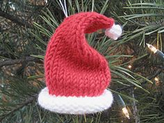 Knitted Santa Hat Ornament Yarn: Lion Brand Micro Spun colors red and white Nee. - Knitted Santa Hat Ornament Yarn: Lion Brand Micro Spun colors red and white Needles: I used size 3 dpns Gauge: 6 stitches = 1 inch Time to … - Christmas Knitting Patterns, Easy Knitting Patterns, Free Knitting, Knitting Projects, Baby Knitting, Knit Christmas Ornaments, Knitted Christmas Stockings, Crochet Christmas, Crochet Santa Hat