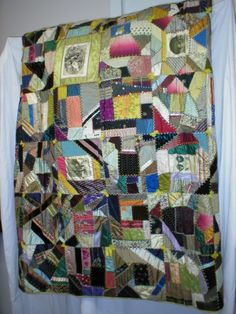 "Circa 1880, Victorian Crazy Quilt. Has a number of political silk ribbons including an American flag, and ribbons for Harrison & Morton, and Harrison & Reilly.  A number of pictorial silk ribbons from milliners and haberdashers are also included in the work, as well as a "" St. Andrews, 1756 "" gold ribbon. Fabrics:silk, satin, velvet, taffeta, brocade, damask, twill, fabric paint, yarn, & embroidery thread.  #chathamhistoricalsociety, #chatham, #capecod, #atwoodhouse"