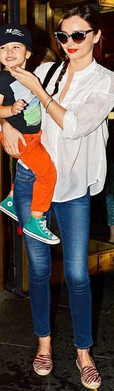 Miranda Kerr: Bracelet – MCS Elena  Jeans – Frame Denim  Sunglasses and shoes – Stella McCartney  Purse – Louis Vuitton