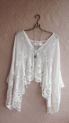 Sheer white crochet pace batwing kimono top with a long necklace , yes...