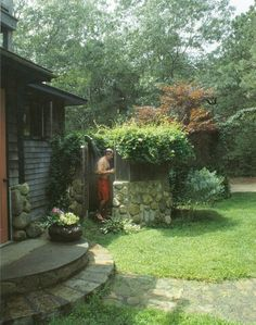 Outdoor Shower  Natural rock wall with lots of greenery