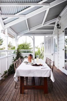 A Brisbane interior designer turned a heritage-listed Queenslander into a colourful and comfortable family home with an artistic decorating approach.