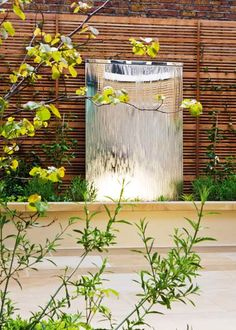 38 Wonderful Outdoor Water Walls For Your Backyard : 38 Amazing Outdoor Water Walls For Your Backyard With Wooden Fence And Natural Stone With Glass Waterfall Design With Plant Decoration And Ceramic Floor Modern Water Feature, Small Water Features, Backyard Water Feature, Water Features In The Garden, Small Fountains, Garden Fountains, Water Fountains, Tabletop Water Fountain, Fountain Ideas