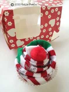 Create a sock cupcake as a gift for a friend, teacher, or neighbor. A sock cupcake is a fast and easy gift to make and can be made for a few dollars.