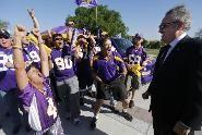 Fans celebrate with Zygi Wilf.