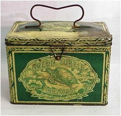 Containers such as this Green Turtle cigar tin, circa the late 1800s, often doubled as a lunch pail, as they were light and sturdy.