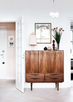 Beautiful wooden colorss on this modern cabinet design | Discover the season's newest interior design trends and inspiration ideas. ➤ To see more ideas visit Sideboards and Buffets Blog and subscribe our newsletter! #homedecorideas #interiordesign #decorideas #luxurybrands #exclusivefurnitue #exclusivebrands #designtrends #designprojects #designideas