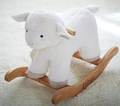 I am obsessed with lambs and giraffes and this lamb rocking horse is fabulous!