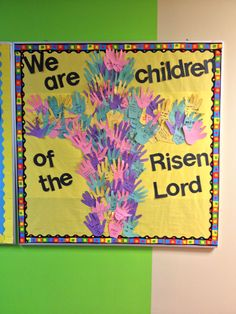 Easter bulletin board.  Kids handprints in shape of the cross.  On handprints kids wrote why they love Jesus.