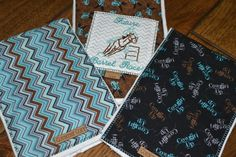Future Barrel Racer  This is a set of 3 Cowgirl Burp Cloths made with 6 ply premium diapers for extra absorbency. One is a brown cotton with turquoise and black boots with a white and off white chevron print square with Future Barrel Racer machine embroidered in coordinating colors. One is a blue gray, brown and black chevron print and the last one is a black cotton with Cowgirl Up written on it in gray, brown and blue. All burp cloths have decorative stitching around them for extra…