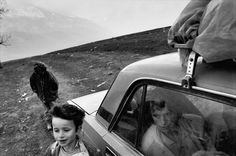 Paolo Pellegrin - ALBANIA. Near the town of Kukes. Refugee family living in a car, 1999