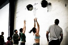 """The adult CrossFit version of """"wall ball"""" vice the kid's version.  150 of these in CrossFit Open WOD 12.4"""