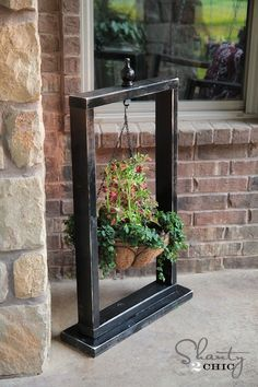 Use a frame as a plant stand and hang at the front of your home.