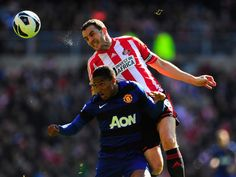 Former United man John O Shea challenges Antonio Valencia in the air. Manchester United Official, Manchester United Premier League, Man Utd News, Barclay Premier League, Own Goal, Sports Images, Sunderland, Old Boys, Photo Galleries