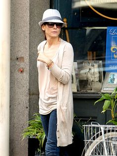 Sandra Bullock dresses up this casual outfit with Alex and Ani bangles!